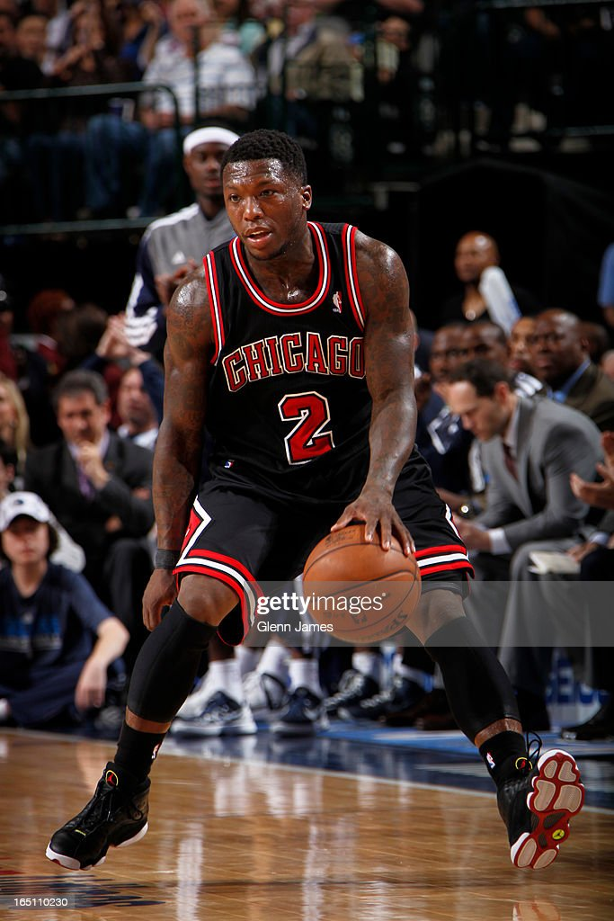 Nate Robinson #2 of the Chicago Bulls dribbles against the Dallas Mavericks on March 30, 2013 at the American Airlines Center in Dallas, Texas.