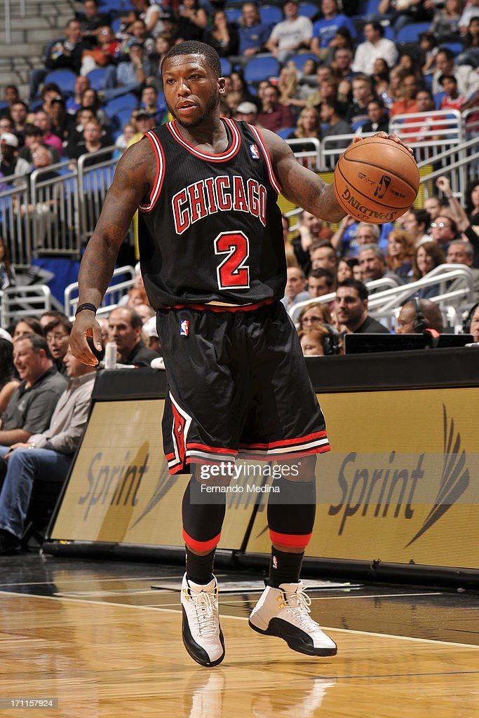 <a gi-track='captionPersonalityLinkClicked' href=/galleries/search?phrase=Nate+Robinson&family=editorial&specificpeople=208906 ng-click='$event.stopPropagation()'>Nate Robinson</a> #2 of the Chicago Bulls dribbles the ball against the Orlando Magic during the game on January 2, 2013 at Amway Center in Orlando, Florida.