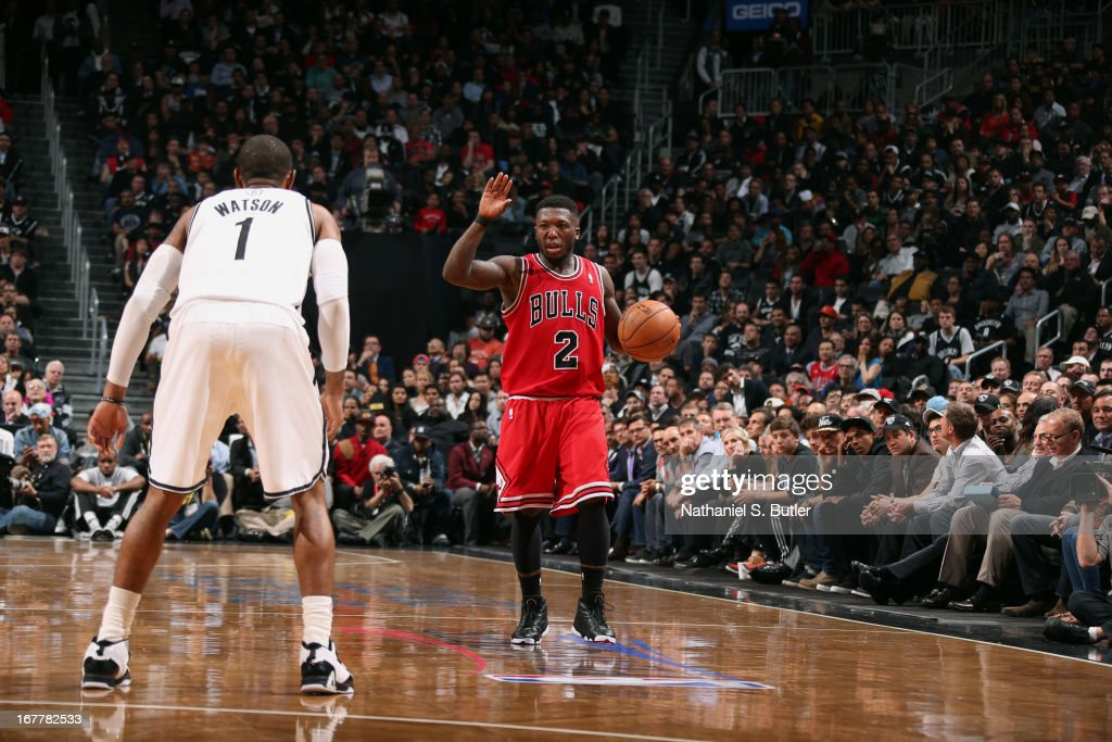 Nate Robinson #2 of the Chicago Bulls dribbles the ball up the court against C.J. Watson #1 of the Brooklyn Nets in Game Five of the Eastern Conference Quarterfinals during the 2013 NBA Playoffs on April 29 at the Barclays Center in the Brooklyn borough of New York City.