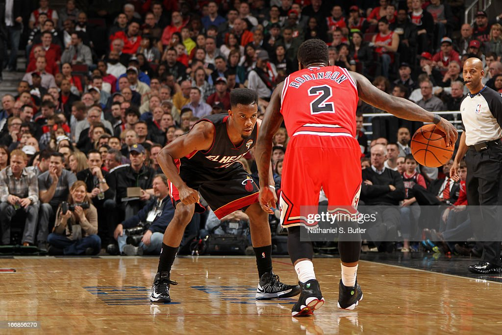 <a gi-track='captionPersonalityLinkClicked' href=/galleries/search?phrase=Nate+Robinson&family=editorial&specificpeople=208906 ng-click='$event.stopPropagation()'>Nate Robinson</a> #2 of the Chicago Bulls dribbles the ball up the court against the Miami Heat Chicago Bulls on March 27, 2013 at the United Center in Chicago, Illinois.
