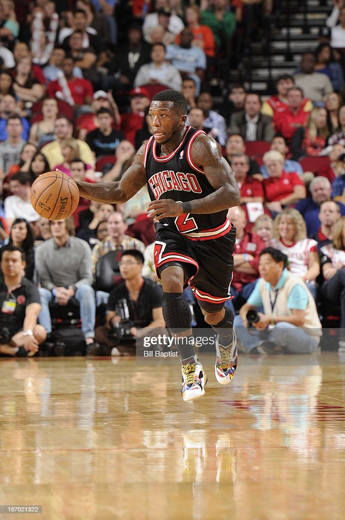 <a gi-track='captionPersonalityLinkClicked' href=/galleries/search?phrase=Nate+Robinson&family=editorial&specificpeople=208906 ng-click='$event.stopPropagation()'>Nate Robinson</a> #2 of the Chicago Bulls dribbles the ball upcourt in the game against the Houston Rockets on November 21, 2012 at the Toyota Center in Houston, Texas.
