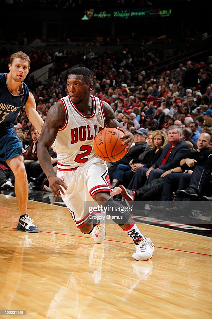 Nate Robinson #2 of the Chicago Bulls drives against Luke Ridnour #13 of the Minnesota Timberwolves on November 10, 2012 at the United Center in Chicago, Illinois.