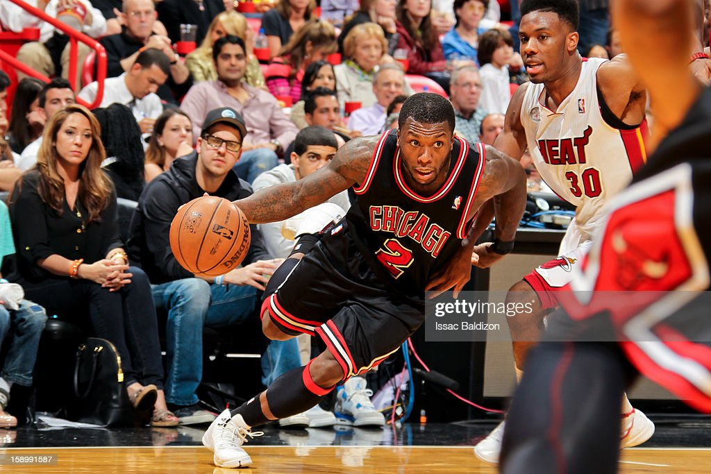 Nate Robinson #2 of the Chicago Bulls drives against Norris Cole #30 of the Miami Heat on January 4, 2013 at American Airlines Arena in Miami, Florida.