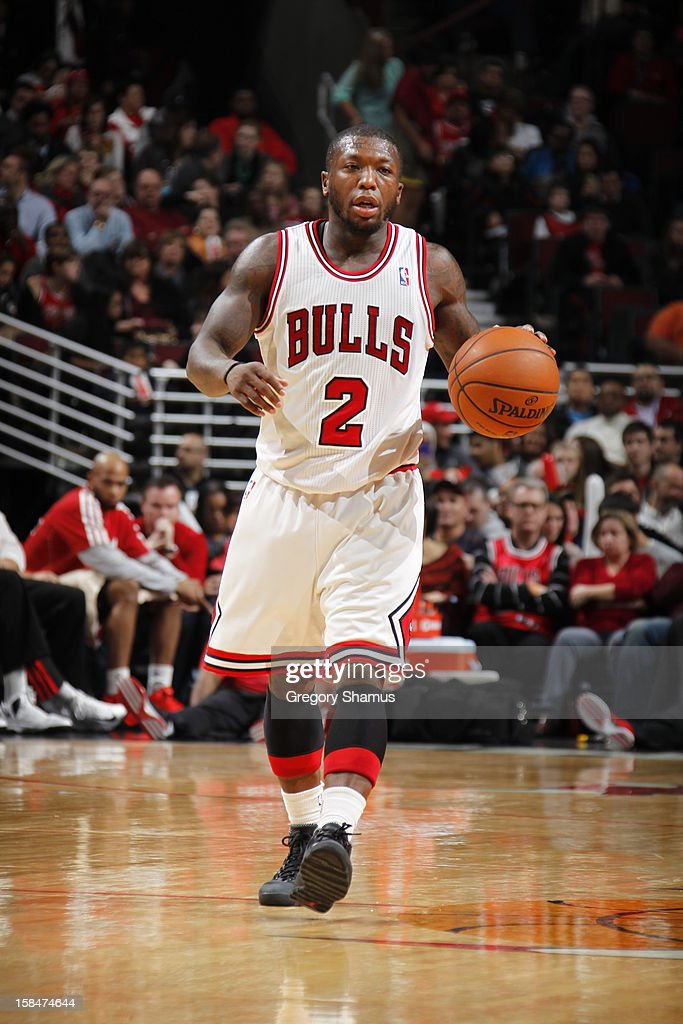 Nate Robinson #2 of the Chicago Bulls drives against the Brooklyn Nets on December 15, 2012 at the United Center in Chicago, Illinois.