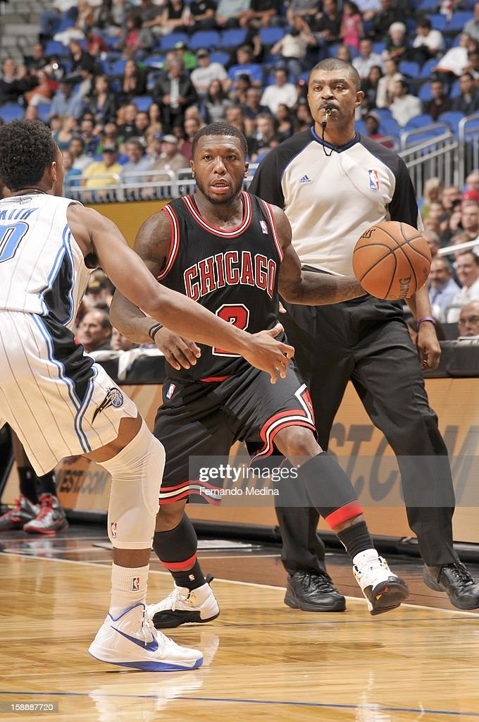 Nate Robinson #2 of the Chicago Bulls drives during the game between the Chicago Bulls and the Orlando Magic on January 2, 2013 at Amway Center in Orlando, Florida.