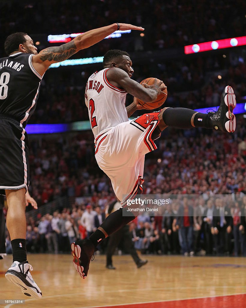 <a gi-track='captionPersonalityLinkClicked' href=/galleries/search?phrase=Nate+Robinson&family=editorial&specificpeople=208906 ng-click='$event.stopPropagation()'>Nate Robinson</a> #2 of the Chicago Bulls drives past <a gi-track='captionPersonalityLinkClicked' href=/galleries/search?phrase=Deron+Williams&family=editorial&specificpeople=203215 ng-click='$event.stopPropagation()'>Deron Williams</a> #8 of the Brooklyn Nets in Game Six of the Eastern Conference Quarterfinals during the 2013 NBA Playoffs at the United Center on May 2, 2013 in Chicago, Illinois. The Nets defeated the Bulls 95-92.
