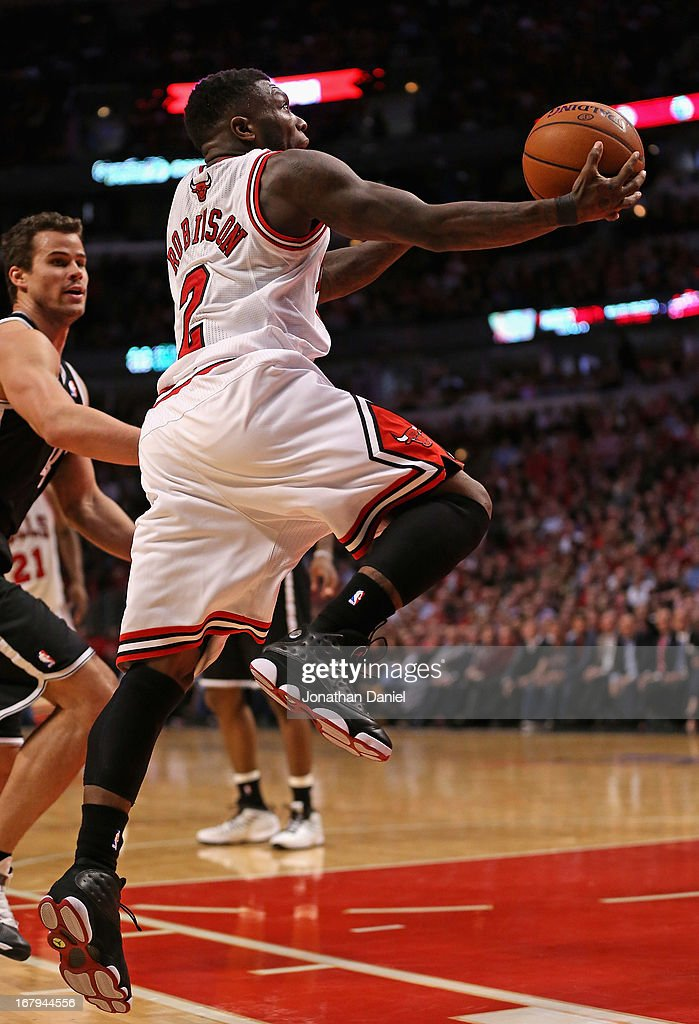 Nate Robinson #2 of the Chicago Bulls drives past Kris Humphries #43 of the Brooklyn Nets in Game Six of the Eastern Conference Quarterfinals during the 2013 NBA Playoffs at the United Center on May 2, 2013 in Chicago, Illinois. The Nets defeated the Bulls 95-92.