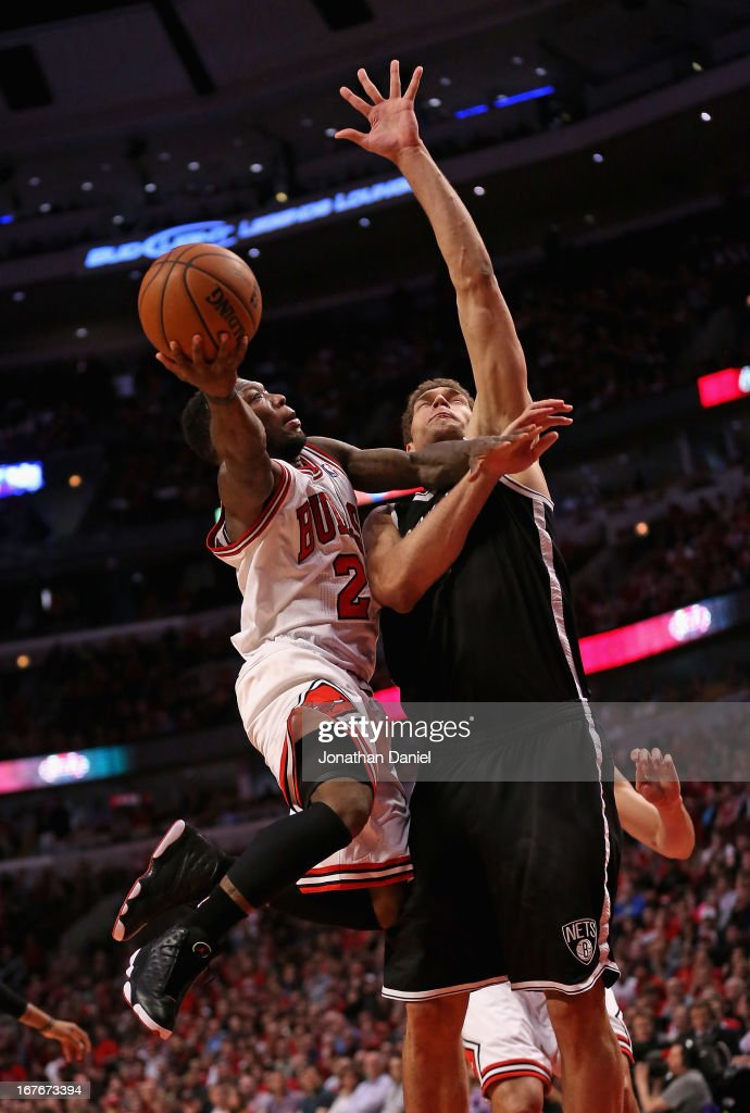 <a gi-track='captionPersonalityLinkClicked' href=/galleries/search?phrase=Nate+Robinson&family=editorial&specificpeople=208906 ng-click='$event.stopPropagation()'>Nate Robinson</a> #2 of the Chicago Bulls drives to the basket against <a gi-track='captionPersonalityLinkClicked' href=/galleries/search?phrase=Brook+Lopez&family=editorial&specificpeople=3847328 ng-click='$event.stopPropagation()'>Brook Lopez</a> #11 of the Brooklyn Nets in Game Five of the Eastern Conference Quarterfinals in the 2013 NBA Playoffs at the United Center on April 27, 2013 in Chicago, Illinois. The Bulls defeated the Nets 142-134 in triple overtime.