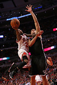 Nate Robinson of the Chicago Bulls drives to the basket against Brook Lopez of the Brooklyn Nets in Game Five of the Eastern Conference Quarterfinals...