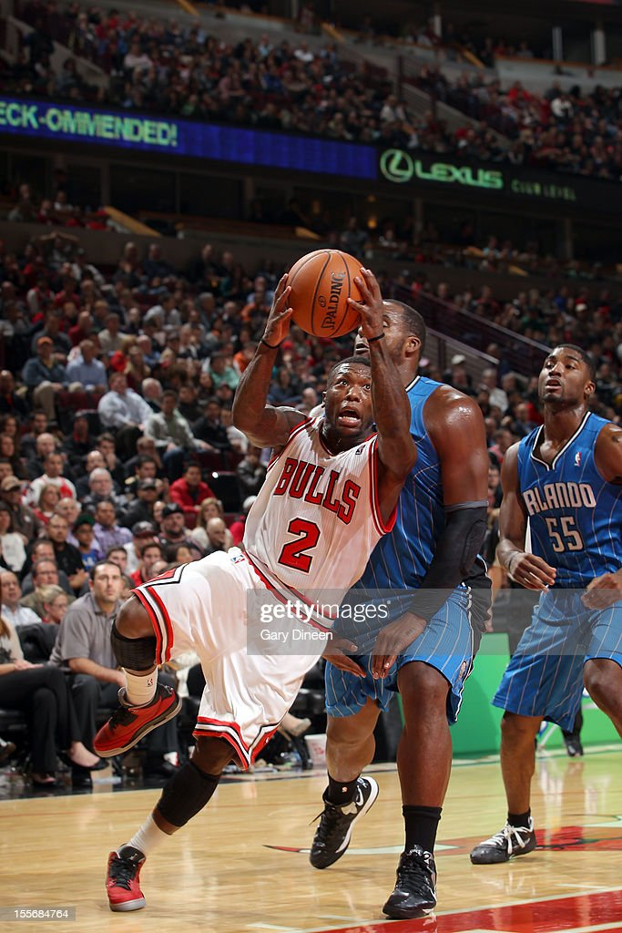 Nate Robinson #2 of the Chicago Bulls drives to the basket against Glen Davis #11 of the Orlando Magic during the NBA game on November 6, 2012 at the United Center in Chicago, Illinois.