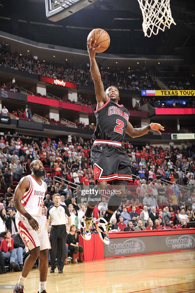 Nate Robinson #2 of the Chicago Bulls drives to the basket against James Harden #13 of the Houston Rockets on November 21, 2012 at the Toyota Center in Houston, Texas.