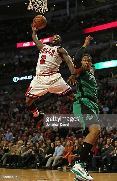 Nate Robinson of the Chicago Bulls drives to the basket against Jared Sullinger of the Boston Celtics at the United Center on December 18 2012 in...