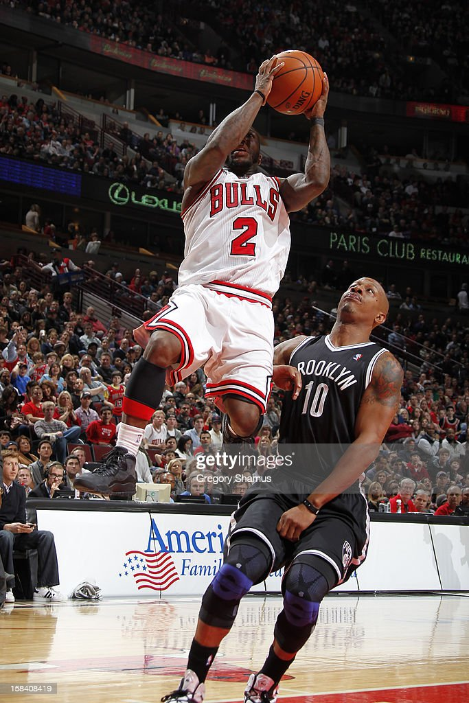 Nate Robinson #2 of the Chicago Bulls drives to the basket against Keith Bogans #10 of the Brooklyn Nets on December 15, 2012 at the United Center in Chicago, Illinois.