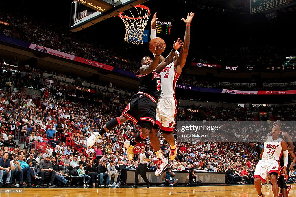 Nate Robinson #2 of the Chicago Bulls drives to the basket against LeBron James #6 of the Miami Heat on January 4, 2013 at American Airlines Arena in Miami, Florida.
