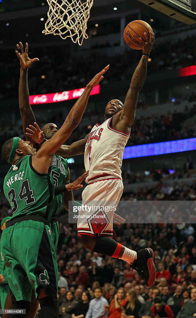 Nate Robinson #2 of the Chicago Bulls drives to the basket against Paul Pierce #34 and Kevin Garnett #5 of the Boston Celtics at the United Center on December 18, 2012 in Chicago, Illinois. The Bulls defeated the Celtics 100-89.