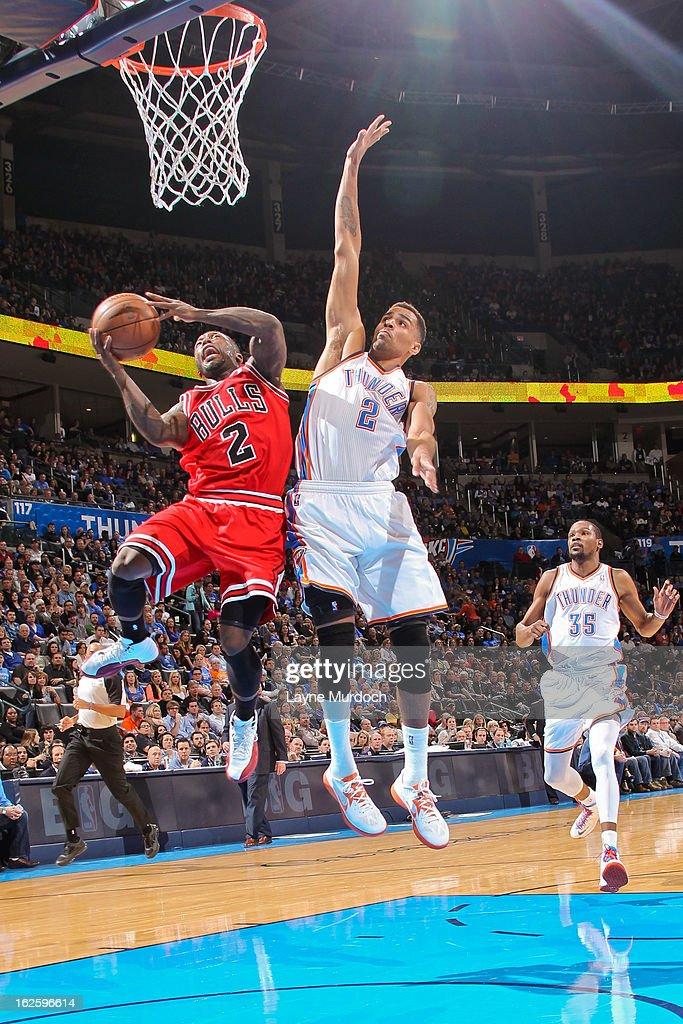 Nate Robinson #2 of the Chicago Bulls drives to the basket against Thabo Sefolosha #2 of the Oklahoma City Thunder on February 24, 2013 at the Chesapeake Energy Arena in Oklahoma City, Oklahoma.