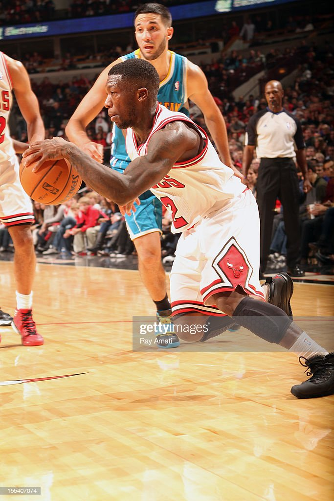 <a gi-track='captionPersonalityLinkClicked' href=/galleries/search?phrase=Nate+Robinson&family=editorial&specificpeople=208906 ng-click='$event.stopPropagation()'>Nate Robinson</a> #2 of the Chicago Bulls drives to the basket against the New Orleans Hornets on November 3, 2012 at the United Center in Chicago, Illinois.