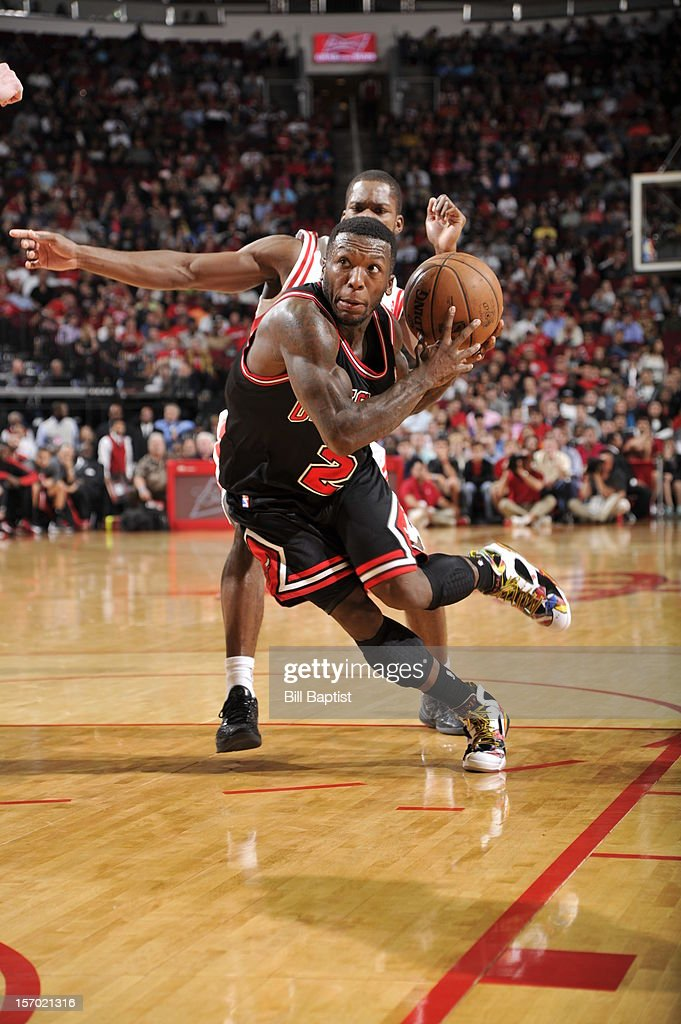 <a gi-track='captionPersonalityLinkClicked' href=/galleries/search?phrase=Nate+Robinson&family=editorial&specificpeople=208906 ng-click='$event.stopPropagation()'>Nate Robinson</a> #2 of the Chicago Bulls drives to the basket against the Houston Rockets on November 21, 2012 at the Toyota Center in Houston, Texas.