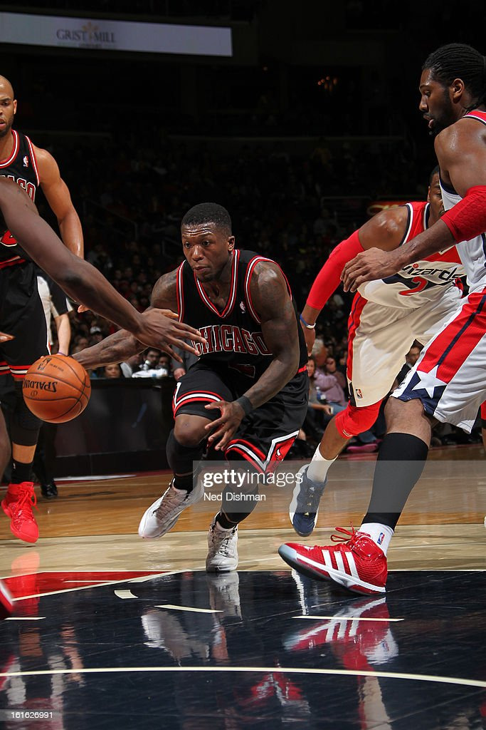 <a gi-track='captionPersonalityLinkClicked' href=/galleries/search?phrase=Nate+Robinson&family=editorial&specificpeople=208906 ng-click='$event.stopPropagation()'>Nate Robinson</a> #2 of the Chicago Bulls drives to the basket against the Washington Wizards at the Verizon Center on January 26, 2013 in Washington, DC.
