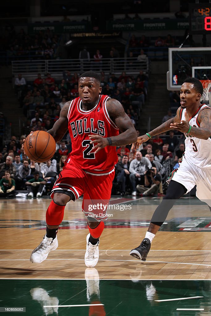 <a gi-track='captionPersonalityLinkClicked' href=/galleries/search?phrase=Nate+Robinson&family=editorial&specificpeople=208906 ng-click='$event.stopPropagation()'>Nate Robinson</a> #2 of the Chicago Bulls drives to the basket against the Milwaukee Bucks on January 30, 2013 at the BMO Harris Bradley Center in Milwaukee, Wisconsin.