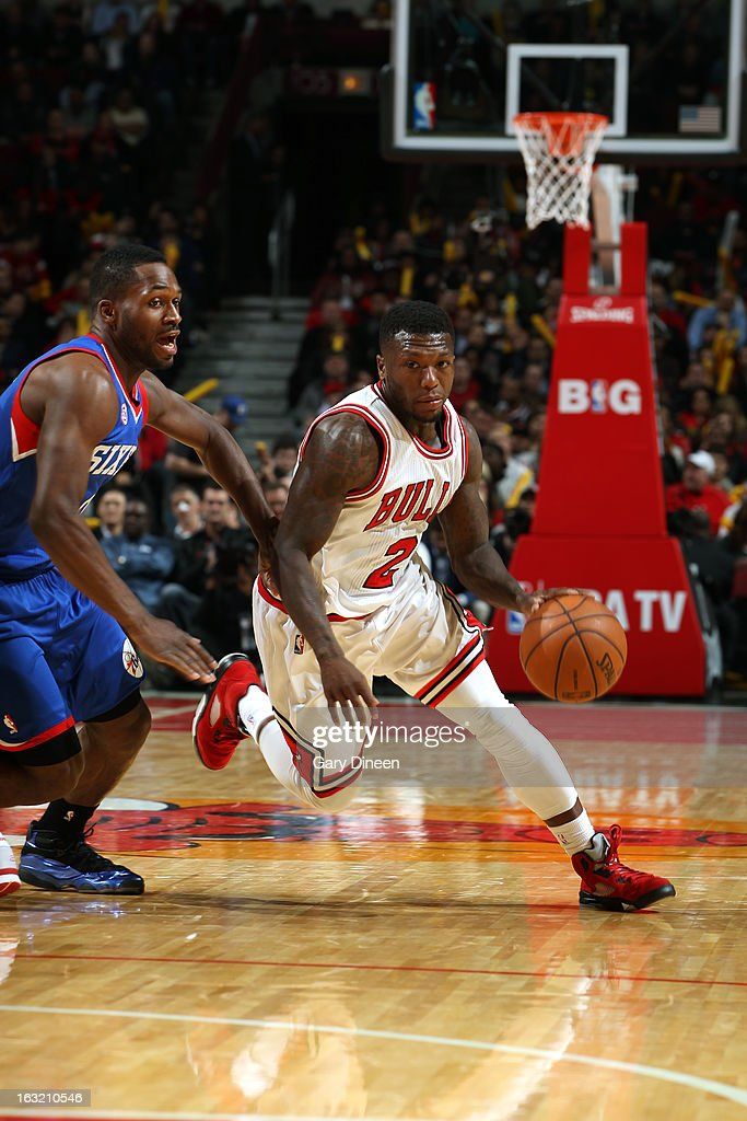 <a gi-track='captionPersonalityLinkClicked' href=/galleries/search?phrase=Nate+Robinson&family=editorial&specificpeople=208906 ng-click='$event.stopPropagation()'>Nate Robinson</a> #2 of the Chicago Bulls drives to the basket against the Philadelphia 76ers on February 28, 2013 at the United Center in Chicago, Illinois.