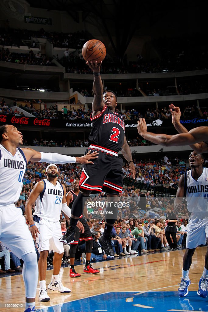 <a gi-track='captionPersonalityLinkClicked' href=/galleries/search?phrase=Nate+Robinson&family=editorial&specificpeople=208906 ng-click='$event.stopPropagation()'>Nate Robinson</a> #2 of the Chicago Bulls drives to the basket against the Dallas Mavericks on March 30, 2013 at the American Airlines Center in Dallas, Texas.
