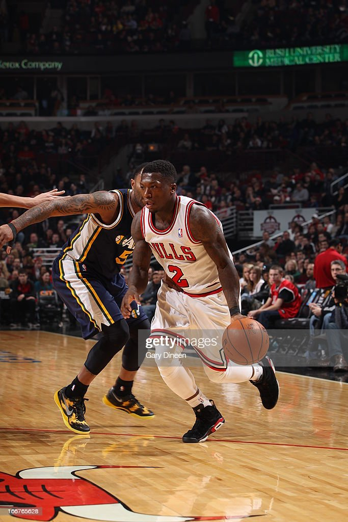 <a gi-track='captionPersonalityLinkClicked' href=/galleries/search?phrase=Nate+Robinson&family=editorial&specificpeople=208906 ng-click='$event.stopPropagation()'>Nate Robinson</a> #2 of the Chicago Bulls drives to the basket against the Utah Jazz on March 08, 2013 at the United Center in Chicago, Illinois.