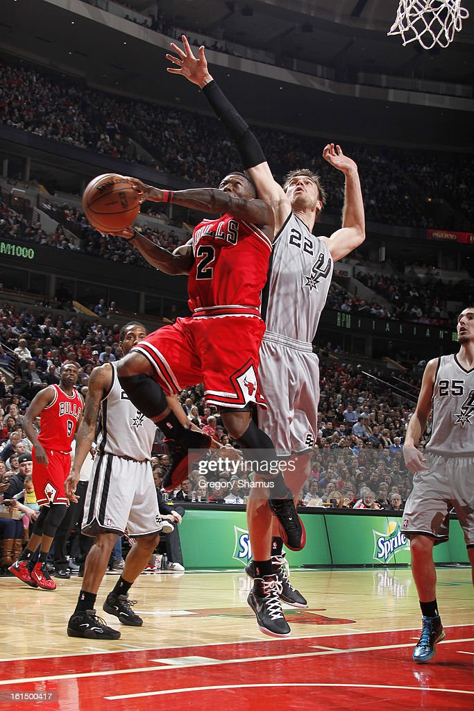 Nate Robinson #2 of the Chicago Bulls drives to the basket against Tiago Splitter #22 of the San Antonio Spurs on February 11, 2013 at the United Center in Chicago, Illinois.