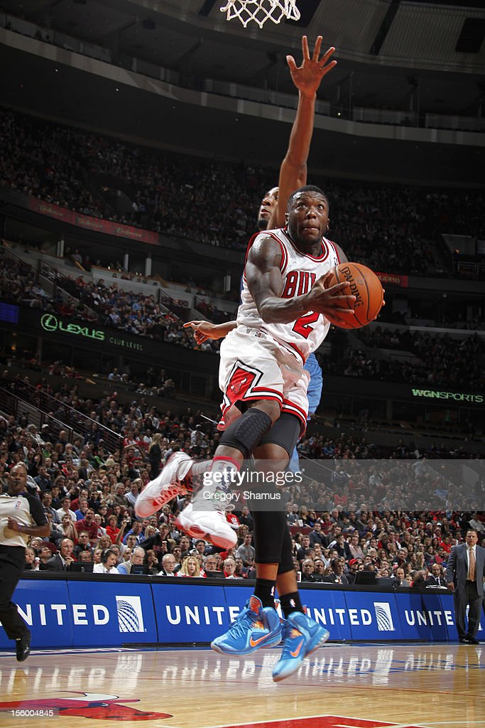 Nate Robinson #2 of the Chicago Bulls drives to the basket past Derrick Williams #7 of the Minnesota Timberwolves on November 10, 2012 at the United Center in Chicago, Illinois.