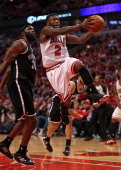 Nate Robinson of the Chicago Bulls drives to the basket past Reggie Evans of the Brooklyn Nets in Game Five of the Eastern Conference Quarterfinals...
