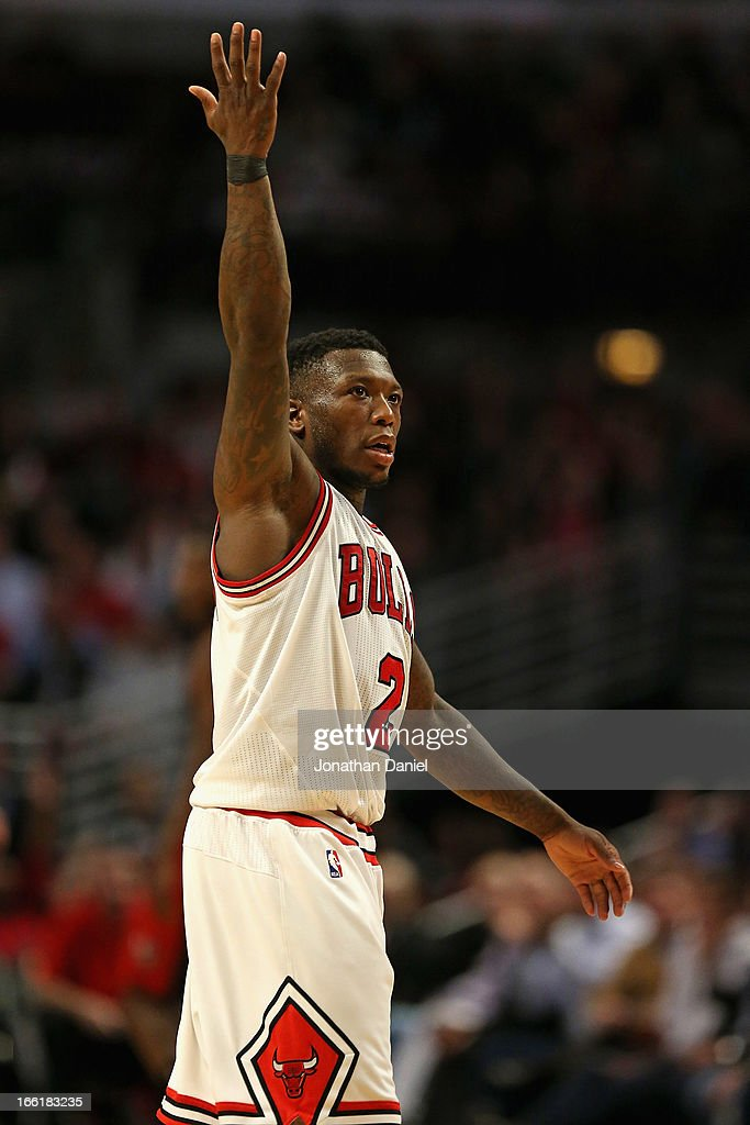 <a gi-track='captionPersonalityLinkClicked' href=/galleries/search?phrase=Nate+Robinson&family=editorial&specificpeople=208906 ng-click='$event.stopPropagation()'>Nate Robinson</a> #2 of the Chicago Bulls encourages the crowd to cheer during a game against the Toronto Raptors at the United Center on April 9, 2013 in Chicago, Illinois. The Raptors defeated the Bulls 101-98.