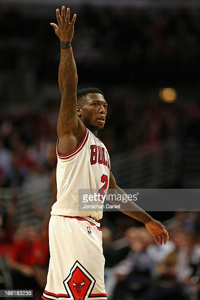Nate Robinson of the Chicago Bulls encourages the crowd to cheer during a game against the Toronto Raptors at the United Center on April 9 2013 in...