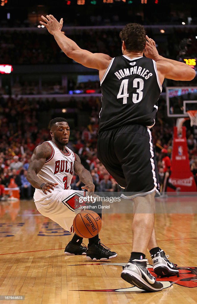 Nate Robinson #2 of the Chicago Bulls fakes Kris Humphries #43 of the Brooklyn Nets in Game Six of the Eastern Conference Quarterfinals during the 2013 NBA Playoffs at the United Center on May 2, 2013 in Chicago, Illinois. The Nets defeated the Bulls 95-92.