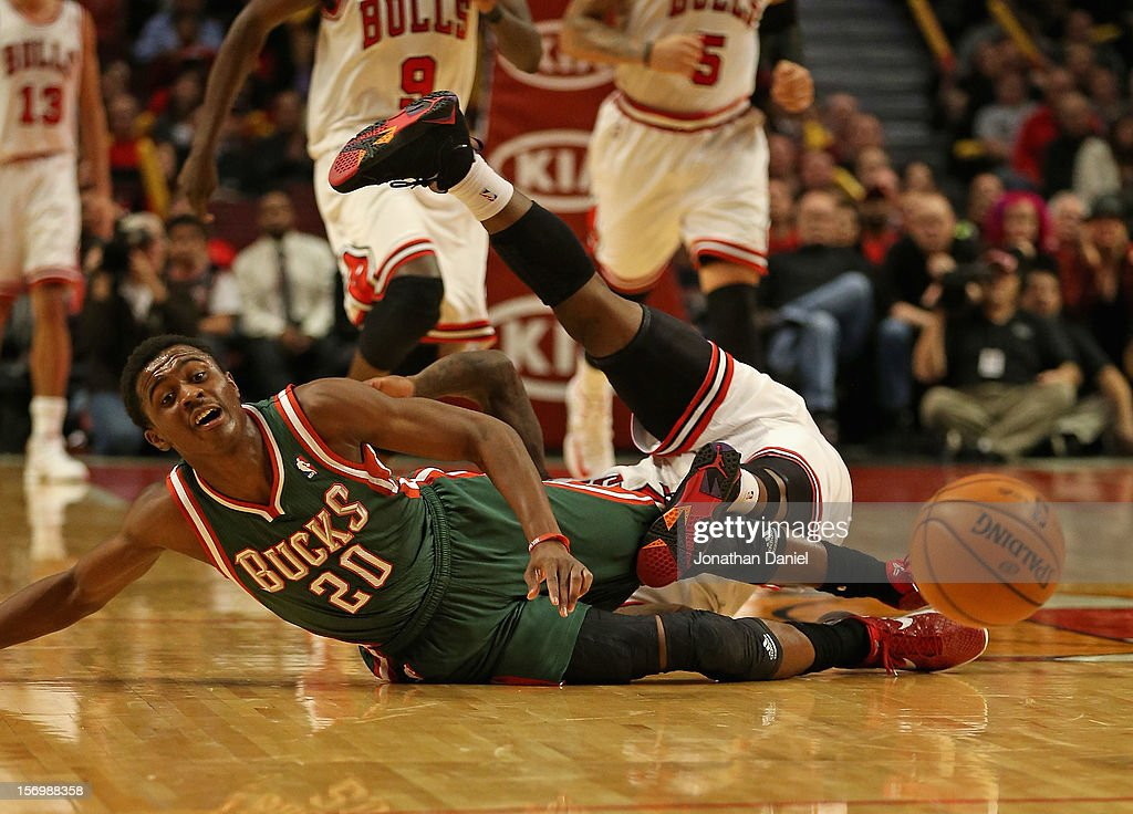 <a gi-track='captionPersonalityLinkClicked' href=/galleries/search?phrase=Nate+Robinson&family=editorial&specificpeople=208906 ng-click='$event.stopPropagation()'>Nate Robinson</a> #2 of the Chicago Bulls falls over <a gi-track='captionPersonalityLinkClicked' href=/galleries/search?phrase=Doron+Lamb&family=editorial&specificpeople=7143029 ng-click='$event.stopPropagation()'>Doron Lamb</a> #20 of the Milwaukee Bucks after a battle for the ball at the United Center on November 26, 2012 in Chicago, Illinois. The Bucks defeated the Bulls 93-92.