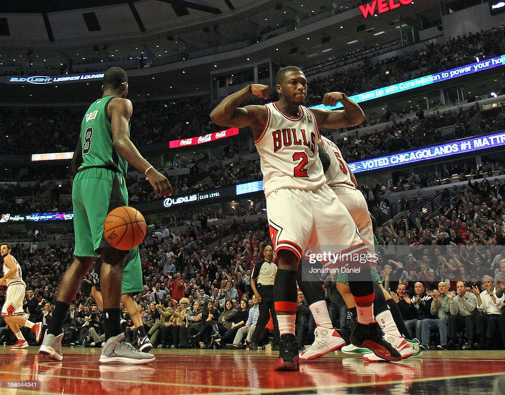 Nate Robinson #2 of the Chicago Bulls flexes after socring against the Boston Celtics at the United Center on December 18, 2012 in Chicago, Illinois. The Bulls defeated the Celtics 100-89.