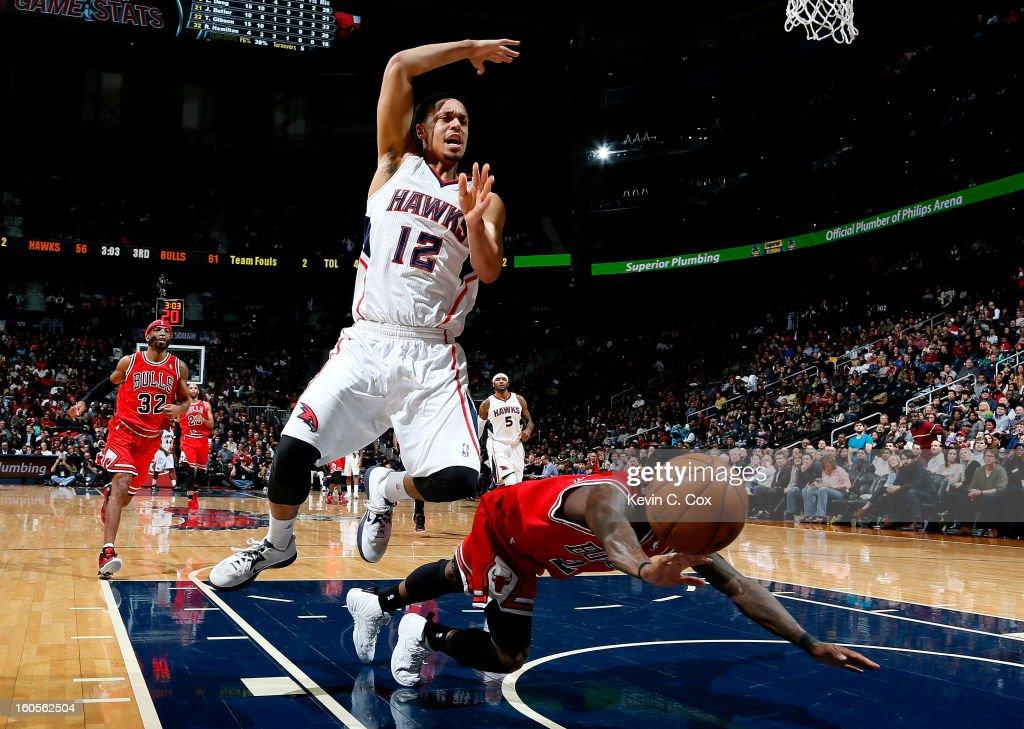 Nate Robinson #2 of the Chicago Bulls fouls John Jenkins #12 of the Atlanta Hawks at Philips Arena on February 2, 2013 in Atlanta, Georgia.