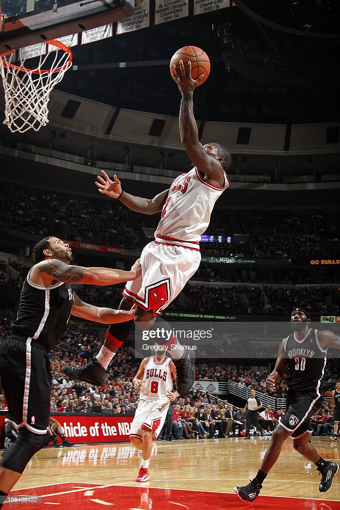 <a gi-track='captionPersonalityLinkClicked' href=/galleries/search?phrase=Nate+Robinson&family=editorial&specificpeople=208906 ng-click='$event.stopPropagation()'>Nate Robinson</a> #2 of the Chicago Bulls goes to the basket against Derron Williams #8 of the Brooklyn Nets on December 15, 2012 at the United Center in Chicago, Illinois.