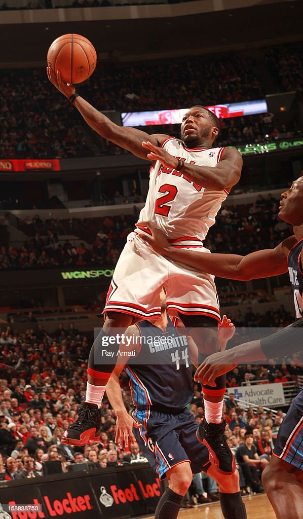 Nate Robinson #2 of the Chicago Bulls goes to the basket past Bismack Biyombo #0 of the Charlotte Bobcats on December 31, 2012 at the United Center in Chicago, Illinois.