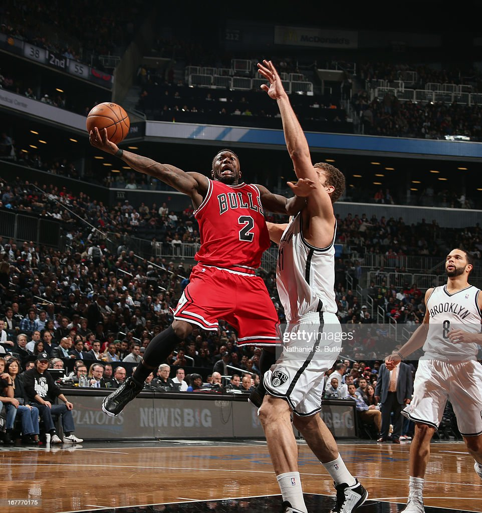 Nate Robinson #2 of the Chicago Bulls goes up against Brook Lopez #11 of the Brooklyn Nets in Game Five of the Eastern Conference Quarterfinals during the 2013 NBA Playoffs on April 29 at the Barclays Center in the Brooklyn borough of New York City.