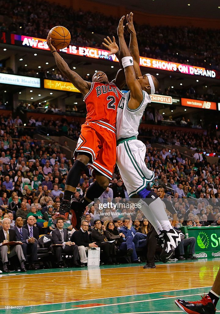Nate Robinson #2 of the Chicago Bulls goes up for a layup against Jason Terry #4 of the Boston Celtics during the game on February 13, 2013 at TD Garden in Boston, Massachusetts.
