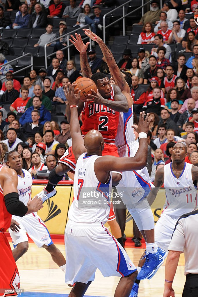 Nate Robinson #2 of the Chicago Bulls goes up for a shot against Matt Barnes #22 of the Los Angeles Clippers at Staples Center on November 17, 2012 in Los Angeles, California.