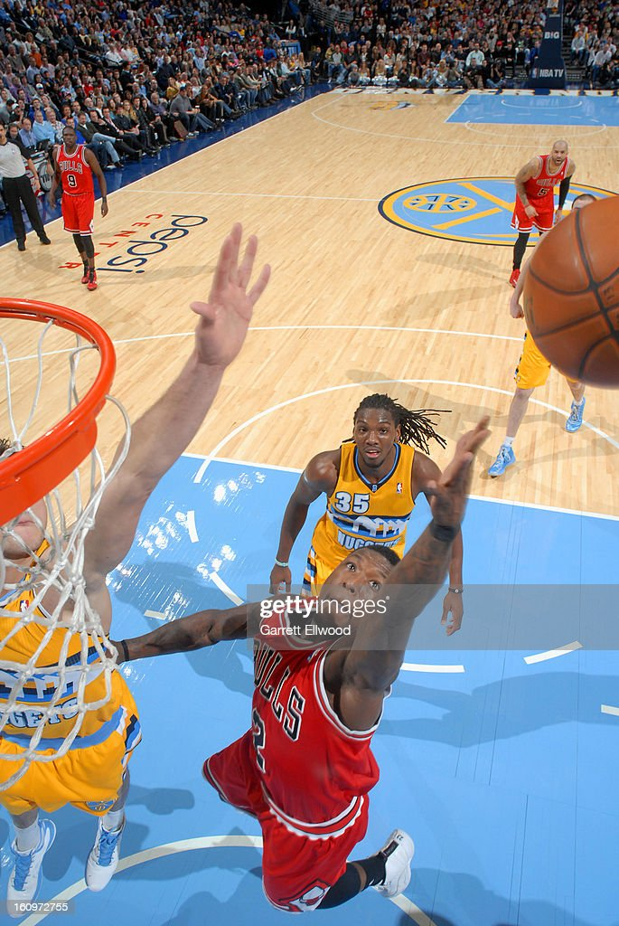 <a gi-track='captionPersonalityLinkClicked' href=/galleries/search?phrase=Nate+Robinson&family=editorial&specificpeople=208906 ng-click='$event.stopPropagation()'>Nate Robinson</a> #2 of the Chicago Bulls grabs the ball against the Denver Nuggets on February 7, 2013 at the Pepsi Center in Denver, Colorado.