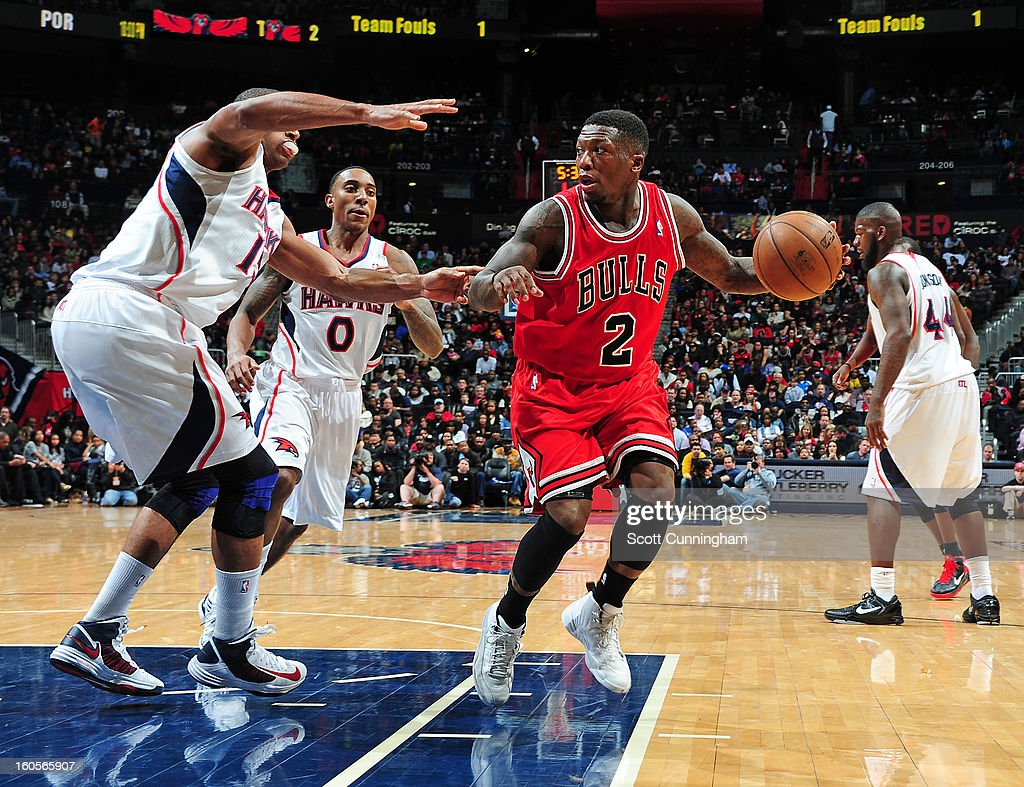 Nate Robinson #2 of the Chicago Bulls handles the ball against the Atlanta Hawks on February 2, 2013 at Philips Arena in Atlanta, Georgia.