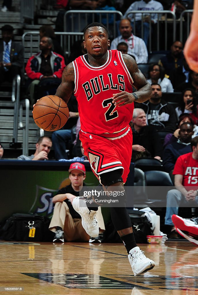 <a gi-track='captionPersonalityLinkClicked' href=/galleries/search?phrase=Nate+Robinson&family=editorial&specificpeople=208906 ng-click='$event.stopPropagation()'>Nate Robinson</a> #2 of the Chicago Bulls handles the ball against the Atlanta Hawks on February 2, 2013 at Philips Arena in Atlanta, Georgia.