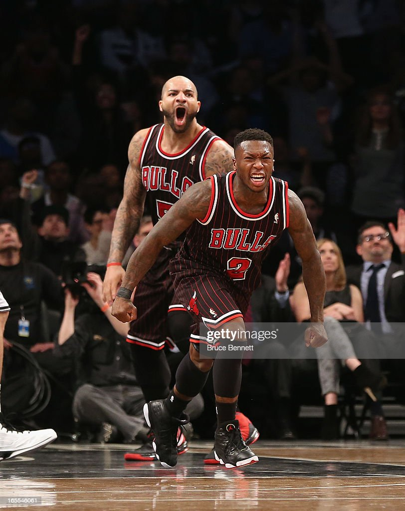<a gi-track='captionPersonalityLinkClicked' href=/galleries/search?phrase=Nate+Robinson&family=editorial&specificpeople=208906 ng-click='$event.stopPropagation()'>Nate Robinson</a> #2 of the Chicago Bulls hits a basket with 22.7 second left against the Brooklyn Nets at the Barclays Center on April 4, 2013 in New York City.