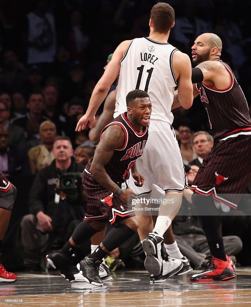 Nate Robinson #2 of the Chicago Bulls hits a basket with 22.7 second left against the Brooklyn Nets at the Barclays Center on April 4, 2013 in New York City.