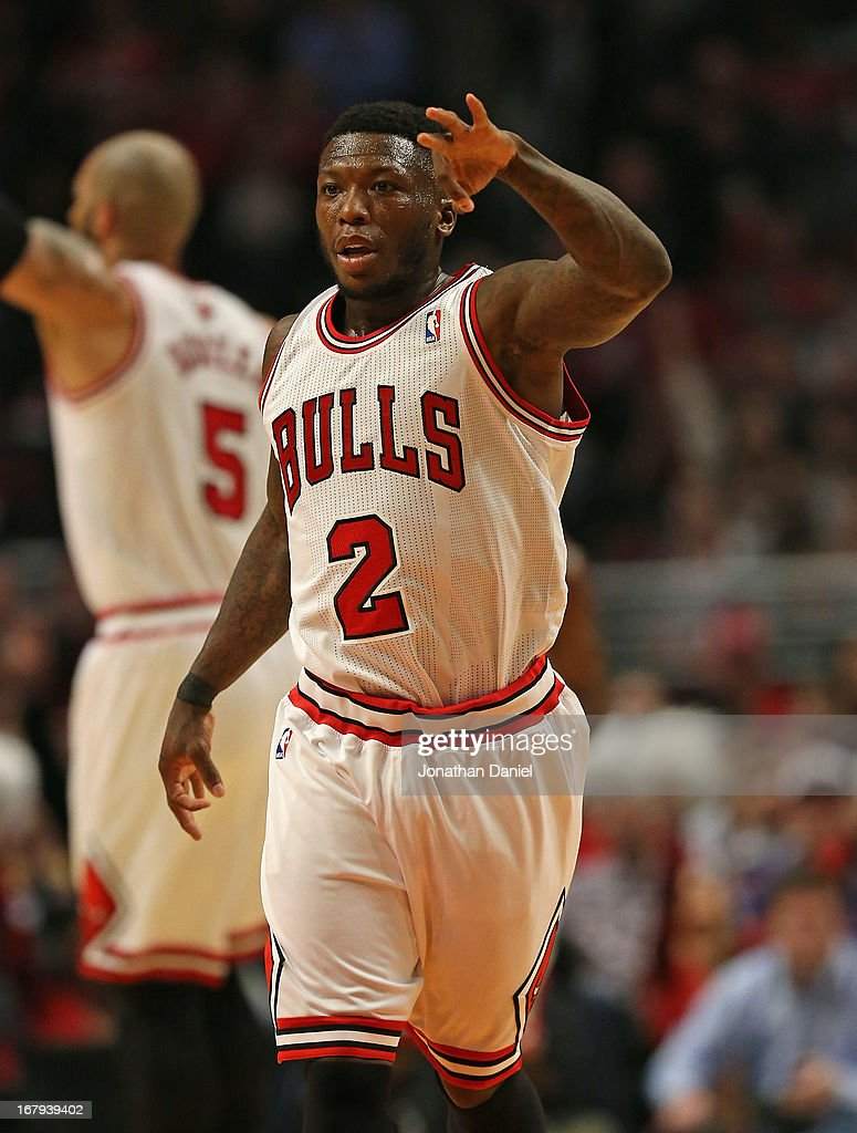 <a gi-track='captionPersonalityLinkClicked' href=/galleries/search?phrase=Nate+Robinson&family=editorial&specificpeople=208906 ng-click='$event.stopPropagation()'>Nate Robinson</a> #2 of the Chicago Bulls holds up 3 fingers after hitting a three point shot against the Brooklyn Nets in Game Six of the Eastern Conference Quarterfinals during the 2013 NBA Playoffs at the United Center on May 2, 2013 in Chicago, Illinois.