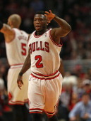 Nate Robinson of the Chicago Bulls holds up 3 fingers after hitting a three point shot against the Brooklyn Nets in Game Six of the Eastern...