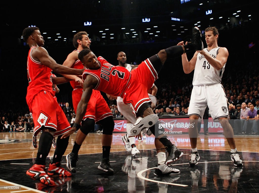 <a gi-track='captionPersonalityLinkClicked' href=/galleries/search?phrase=Nate+Robinson&family=editorial&specificpeople=208906 ng-click='$event.stopPropagation()'>Nate Robinson</a> #2 of the Chicago Bulls is called for a foul in the fourth quarter against the Brooklyn Nets during Game Two of the Eastern Conference Quarterfinals of the 2013 NBA Playoffs at the Barclays Center on April 22, 2013 in New York City.