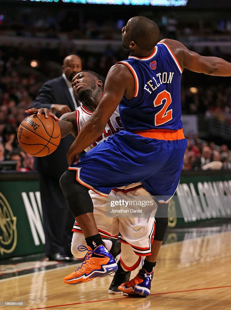 <a gi-track='captionPersonalityLinkClicked' href=/galleries/search?phrase=Nate+Robinson&family=editorial&specificpeople=208906 ng-click='$event.stopPropagation()'>Nate Robinson</a> #2 of the Chicago Bulls is fouled by <a gi-track='captionPersonalityLinkClicked' href=/galleries/search?phrase=Raymond+Felton&family=editorial&specificpeople=209141 ng-click='$event.stopPropagation()'>Raymond Felton</a> #2 of the New York Knicks at the United Center on April 11, 2013 in Chicago, Illinois. The Bulls defeated the Knicks 118-111 in overtime.
